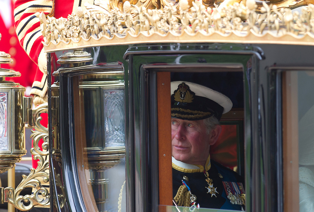 Britain's Prince Charles rides in a carriage to Buckingham Palace after the Royal Wedding for Britain's Prince William and his wife Kate, Duchess of Cambridge in London Friday, April, 29, 2011. (AP Photo/Bogdan Maran)
