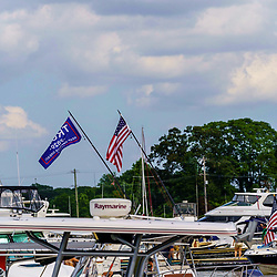Chesapeake City, MD, USA - June 28. 2020: Boats tied to dock on the Chesapeake and Delaware Canal.