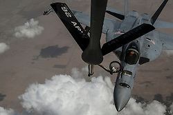 A KC-135 Stratotanker refuels a Navy F/A-18E Super Hornet over Iraq June 15, 2018.  (U.S. Air Force Photo by Staff Sgt. Corey Hook)