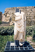 Remains of a headless greek marble statue, Photographed at Israel, caesarea