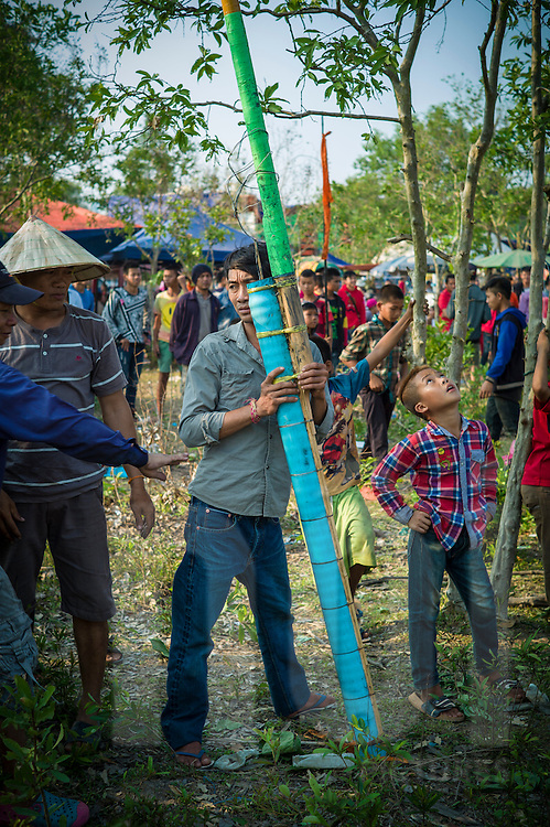 Portrait of a laotian holding his rocket  during Boun Bang Fai, aka Rocket Festival, Ban Don Nieng, a small village near Vientiane, Laos, Southeast Asia