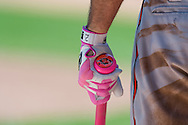 A close up view of the pink bat and batting glove used by J.J. Hardy #2 of the Baltimore Orioles on Mother's Day against the Minnesota Twins on May 12, 2013 at Target Field in Minneapolis, Minnesota.  The Orioles defeated the Twins 6 to 0.  Photo: Ben Krause