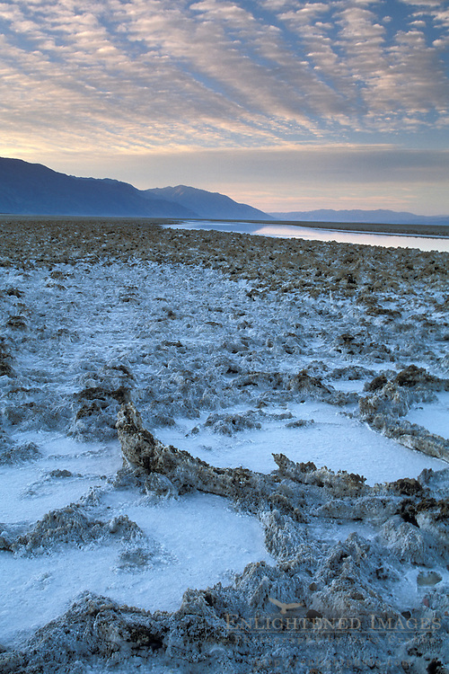 Black Mountains and flooded salt pan at sunrise, Devils Golf Course, Middle Basin, Death Valley, California