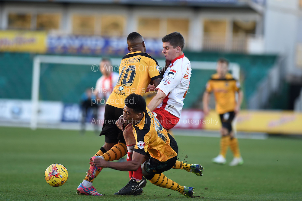 Shaun Jeffers of Newport county (14) falls in a collision. Skybet football league two match, Newport county v Stevenage at Rodney Parade in Newport, South Wales on Saturday 13th December 2014<br /> pic by Andrew Orchard, Andrew Orchard sports photography.