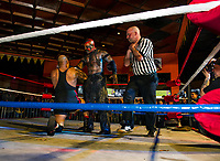 The Boogey Man brings Don Vega to his knees in a choke hold during Pro Wrestling Injustice for Brawl at the Whiskey Barrel on Saturday evening.  (Karen Bobotas/for the Laconia Daily Sun)