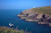 White navigation beacon and fishing boat Porthgain, Pembrokeshire national park, Wales