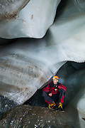 Stephen Jennings explores a large chamber in an ice cave in Larsbreen, Svalbard.