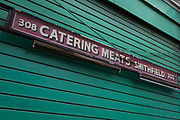 Closed shutters on a butchers business in Smithfield Market, on 9th February 2017, in City of London, England. Smithfield Market has been at this location since medieval times but is about to undergo redevelopment and gentrification, disliked by traditionalists.