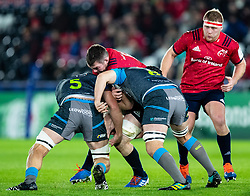 Peter O'Mahony of Munster  under pressure from  Lloyd Ashley of Ospreys<br /> <br /> Photographer Simon King/Replay Images<br /> <br /> European Rugby Champions Cup Round 1 - Ospreys v Munster - Saturday 16th November 2019 - Liberty Stadium - Swansea<br /> <br /> World Copyright © Replay Images . All rights reserved. info@replayimages.co.uk - http://replayimages.co.uk