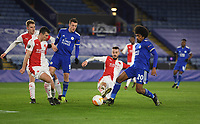Football - 2020 / 2021 Europa League - Round of 32 - Second Leg - Leicester City vs Slavia Prague - King Power Stadium<br /> <br /> Leicester City's Hamza Choudhury is tackled by Slavia Prague's Jakub Hromada - no penalty.<br /> <br /> COLORSPORT/ASHLEY WESTERN