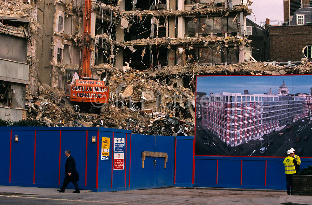In the heart of the City of London, a caterpillar tracked crane tears down the walls of an old 70s office block close to St Paul's Cathedral, England. As a pedestrian walks past the blue hoardings that protect passers-by like him, the rubble is piled high before being removed as spoil to make way for an brand new construction that appears in an artist's impression picture on the right, above two site engineers wearing fluorescent jackets and hard hats. This is a scene of renewal in London's financial district. Of optimism and regeneration as businesses invest in new workplaces and replacing the tired, old offices that cannot accommodate new computer and server cabling technology.