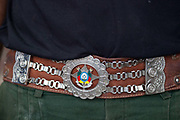 Detail shot of Gaucho leather and chrome belt. Gaucho cowboy Rodeo, Flores de Cunha, Rio Grande do Sul.