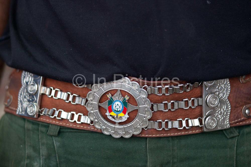 Detail shot of Gaucho leather and chrome belt. Gaucho cowboy Rodeo, Flores de Cunha, Rio Grande do Sul.