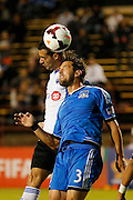Montreal Impact forward Andrés Romero (15) and San Jose Earthquakes defender Dan Gargan (3) battle for a head ball in the second half of the game at Buck Shaw Stadium in Santa Clara, California, on September 17, 2013.  The San Jose Earthquakes beat Montreal Impact 3-0. (Stan Olszewski/QMI Agency)