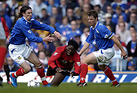 Photo. Richard Lane, Digitalsport..<br /> Portsmouth v Manchester United. FA Barclaycard Premiership. 17/04/2004.<br /> Louis Saha is brought down by Dejan Stefanovic and Arjan De Zeeuw.