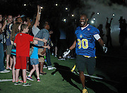 Isaac Bruce is introduced before the flag football began. The proceeds from the event went towards his foundation.