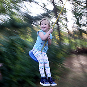 NEW YORK, NEW YORK - OCTOBER 22: A three year old girl swinging on a rope tied to a tree. Manhattan, New York. 22nd October 2017. (Photo by Tim Clayton/Corbis via Getty Images)