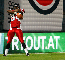 11.07.2011, UPC Arena, Graz, AUT, American Football WM 2011, Group B, Kanada (CAN) vs Oesterreich (AUT), im Bild Shamawd Chambers (Canada, #84, R) is proud after his touchdown// during the American Football World Championship 2011 Group B game, Canada vs Austria, at UPC Arena, Graz, 2011-07-11, EXPA Pictures © 2011, PhotoCredit: EXPA/ E. Scheriau