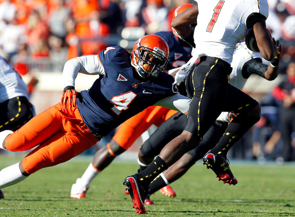 Virginia Cavaliers fullback LoVante' Battle (4) tries to tackle Maryland Terrapins wide receiver Stefon Diggs (1) during the game in Charlottesville, Va. Maryland defeated Virginia 27-20.