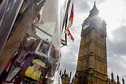 Queen Elizabeth appears on a rack of postcards in Westminster, central London.