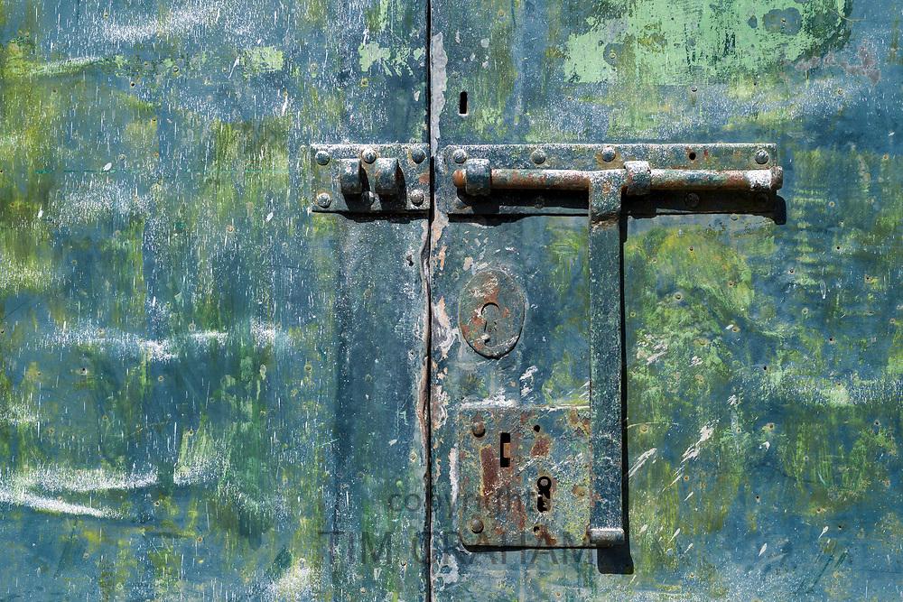 Unusual green pained doorway with lock and bolt in V|la Nova de Gaia in Porto, Portugal