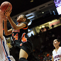 031314  Adron Gardner/Independent<br /> <br /> Gallup Bengal Ni'asia McIntosh (34) attempts a layup while under pressure from Los Lunas Tiger Teige Zeller  (33) during the state high school basketball tournament at The Pit in Albuquerque Thursday.
