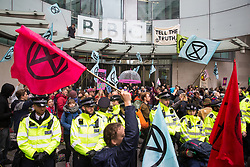 London, UK. 11 October, 2019. Climate activists from Extinction Rebellion block the main entrance to the BBC's New Broadcasting House on the fifth day of International Rebellion protests. They were demanding that the broadcaster 'tell the truth' regarding the climate emergency.