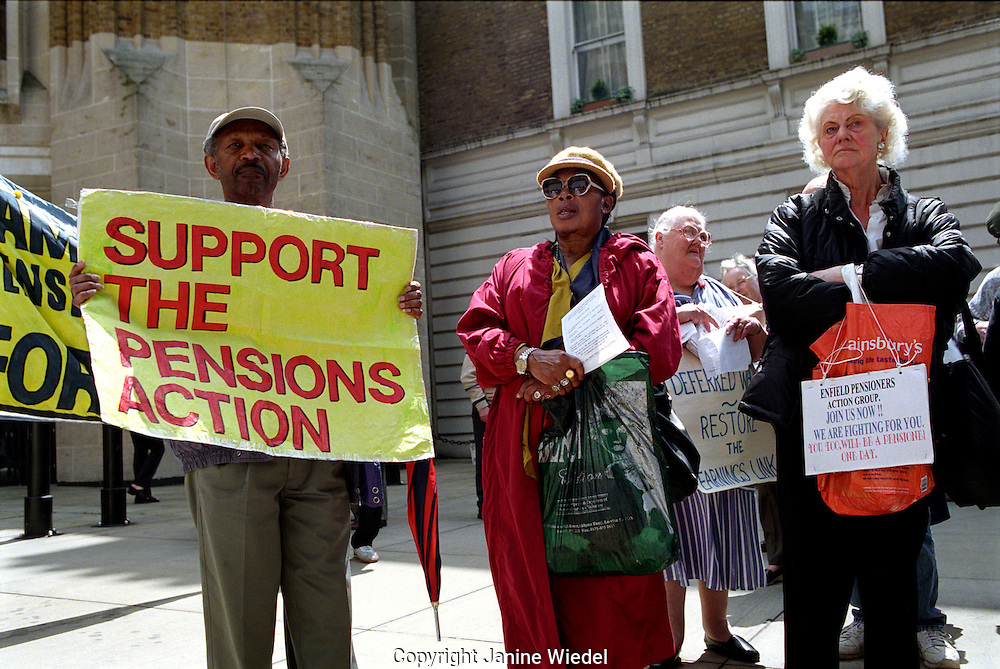 Pensioners attending rally outside Downing Street in Whitehall, London.