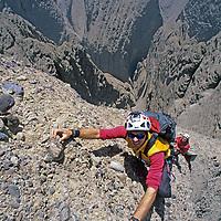 Sam Lightner (MR) climbs on Shipton's Arch - one of earth's biggest rock spans, Tushag Tagh Mountains, near Kashgar.