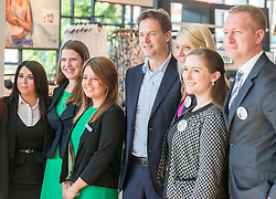 ***EMBARGO UNTIL 0001 FRIDAY 18th JULY 2014***© Licensed to London News Pictures. 16/07/2014. London, UK. NICK CLEGG (C) and JO SWINSON (2nd from left) pose with employees for a photograph.  Deputy Prime Minister and Leader of the Liberal Democrats Nick Clegg visits Tesco in Kensington to meet staff along with Jo Swinson. The Liberal Democrats will say in their 2015 manifesto that they will require large companies to publish the average salary of their male and female employees, increasing public pressure for equal pay. Tesco are one of the companies that currently publish this information voluntarily under the Government's Think, Act, Report scheme.. Photo credit : Stephen Simpson/LNP