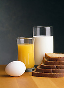 Still life of various nutritious breakfast items on a butcher block