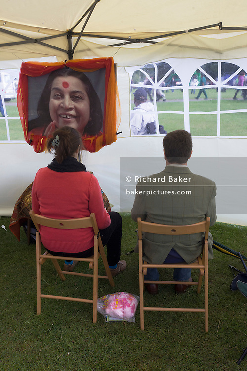 A Western couple sit in meditation looking at a portrait of the Indian guru Shri Mataji Nimala Devi, at south London's Lambeth Show. Nirmala Srivastava (née Nirmala Salve, more widely known as Shri Mataji Nirmala Devi) (March 21, 1923 - February 23, 2011) was the founder of Sahaja Yoga, a new religious movement. She proclaimed that she was the complete incarnation of the Adi Shakti, and is recognized as such by devotees in 140 countries. Nirmala Srivastava died on February 23, 2011, in Genoa, Italy at the age of 87.