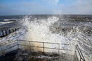 Wave swash hitting sea wall, Felixstowe, Suffolk, England