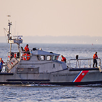 The 47 ft Motor Lifeboat (MLB) 47315, in service with the U.S. Coast Guard (USCG), is designed to perform heavy weather rescue in hurricane force winds and 20-foot breaking seas. This all-aluminum marine innovation withstands impacts of three times the acceleration of gravity, and can even survive a complete roll-over, self-righting in less than 10 seconds with all machinery remaining fully operational.   Here the MLB with a full crew returns from drills in Sandy Hook Bay New Jersey