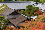 "Fall foliage colors at Ginkaku-ji (""Temple of the Silver Pavilion""), officially named Jisho-ji (""Temple of Shining Mercy""). Ginkaku-ji is a Zen temple along Kyoto's eastern mountains (Higashiyama), in Japan. Despite its name, Silver Pavilion was never covered in silver, though silvery moon light reflecting off its former black lacquer may explain its name. In 1482, shogun Ashikaga Yoshimasa built his retirement villa on the grounds of today's temple, modeling it after Kinkakuji (Golden Pavilion), his grandfather's retirement villa at the base of Kyoto's northern mountains (Kitayama). The villa was converted into a Zen temple after Yoshimasa's death in 1490."