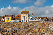 Brightly colored painted houses and fisherman's lookout tower on the sea front beach at Aldeburgh, East Anglia, Suffolk, England .<br /> <br /> Visit our ENGLAND PHOTO COLLECTIONS for more photos to download or buy as wall art prints https://funkystock.photoshelter.com/gallery-collection/Pictures-Images-of-England-Photos-of-English-Historic-Landmark-Sites/C0000SnAAiGINuEQ