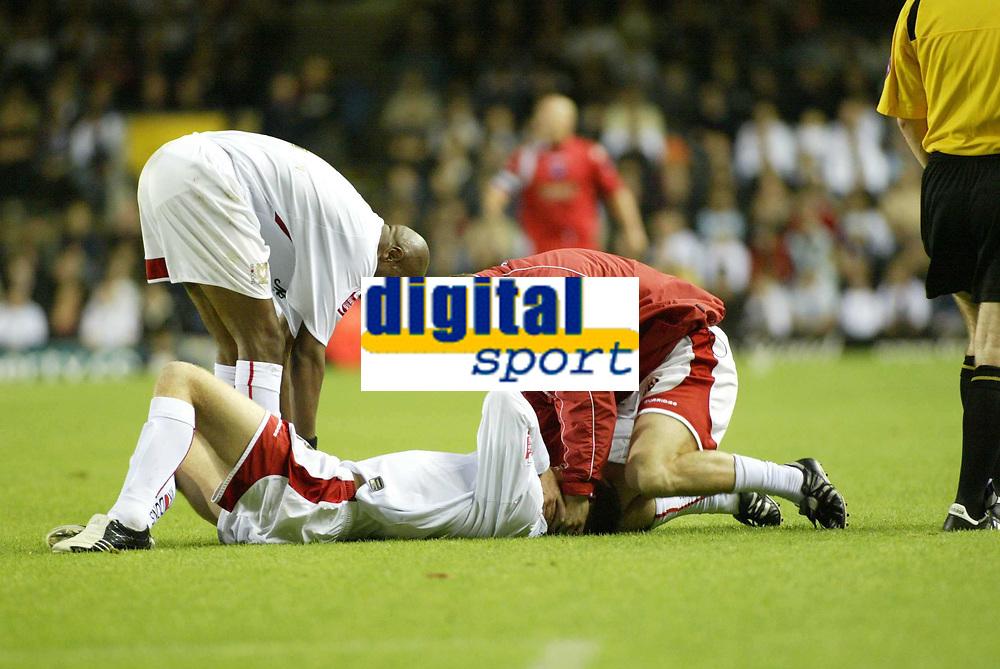 Photo: Marc Atkins.<br /> Milton Keynes Dons v Peterborough United. Coca Cola League 2. 06/10/2006.<br /> <br /> Aaron Wilbraham of MK Dons recieves medical attention.