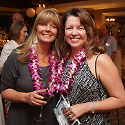 Susan Wasserman, left, and Donna Hickman pose for a photo Saturday August 2, 2014 during Pipeline to a Cure, a benefit for Cystic Fibrosis at the Country Club of Landfall in Wilmington, N.C. (Jason A. Frizzelle)