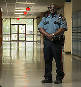 Houston ISD campus police officer Vincent Jones poses for a photograph at Holland Middle School, April 1, 2014. Jones was named Houston ISD Employee of the Month for June 2013.