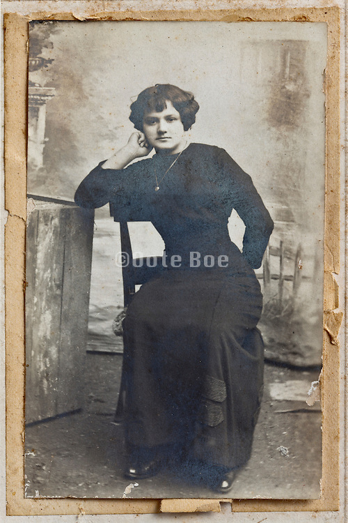 1914 portrait of woman in studio garden decor setting