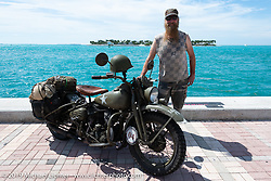 Randy Samz with his 1942 Harley-Davidson WLA at the end of the Cross Country Chase motorcycle endurance run from Sault Sainte Marie, MI to Key West, FL. (for vintage bikes from 1930-1948). The Grand Finish in Key West's Mallory Square after the 110 mile Stage-10 ride from Miami to Key West, FL and after covering 2,368 miles of the Cross Country Chase. Sunday, September 15, 2019. Photography ©2019 Michael Lichter.