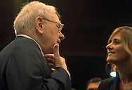 5/5/07  Omaha NE  Warren Buffett talks with media from all over the world on the floor at Qwest Center Omaha just before the start of the Berkshire Hathaway annual meeting Saturday morning...(photo by Chris Machian/Prarie Pixel Group).