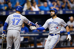 August 23, 2017 - St. Petersburg, Florida, U.S. - WILL VRAGOVIC   |   Times.Toronto Blue Jays shortstop Ryan Goins (17) high fives center fielder Kevin Pillar (11) at the plate after his home run in the eighth inning of the game between the Toronto Blue Jays and the Tampa Bay Rays at Tropicana Field in St. Petersburg, Fla. on Wednesday, Aug. 23, 2017. (Credit Image: © Will Vragovic/Tampa Bay Times via ZUMA Wire)