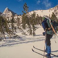 Snow surveyors for the Califonria Department of Water Resources ski deep into the Sierra Nevada backcountry measure the snowpack below Kearsarge Pass in  John Muir Wilderness.