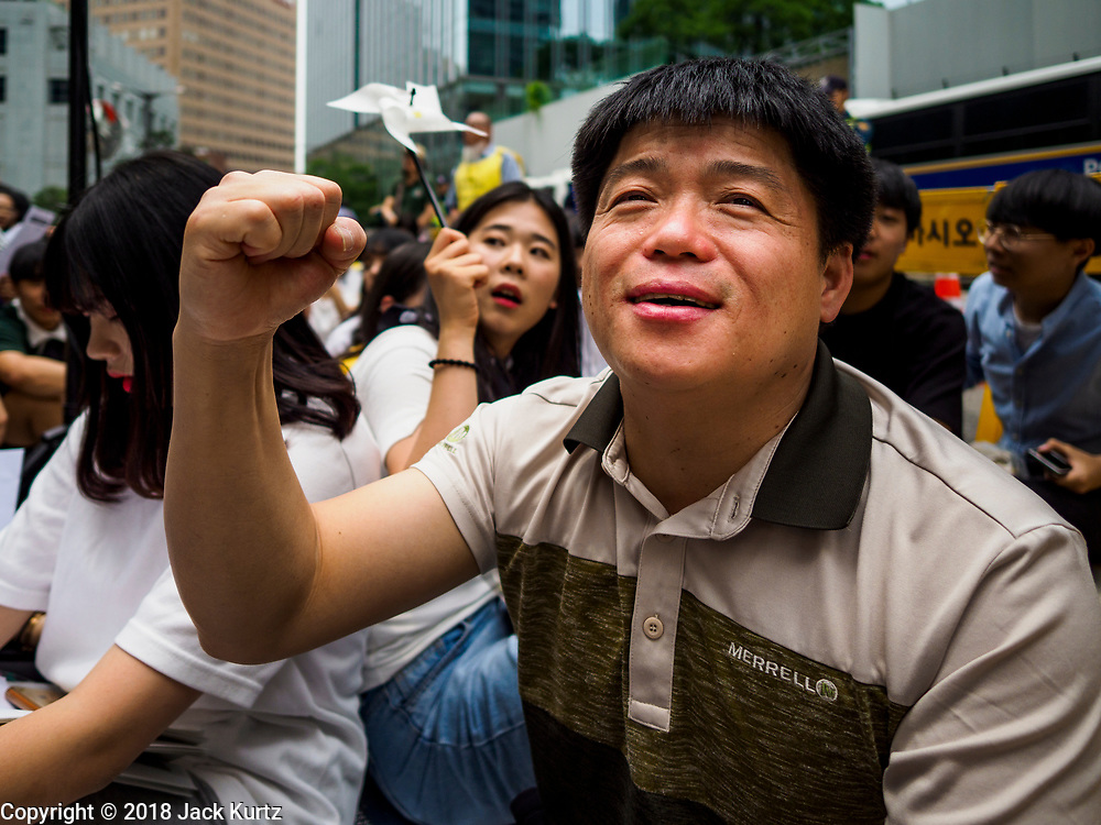 """SEOUL, SOUTH KOREA: A South Korean man chants against the Japanese refusal to apologize for using Korean women as sex slaves during World War II. The Wednesday protests have been taking place since January 1992. Protesters want the Japanese government to apologize for the forced sexual enslavement of up to 400,000 Asian women during World War II. The women, euphemistically called """"Comfort Women"""" were drawn from territories Japan conquered during the war and many came from Korea, which was a Japanese colony in the years before and during the war. The """"comfort women"""" issue is still a source of anger of many people in northeast Asian areas like South Korea, Manchuria and some parts of China.         PHOTO BY JACK KURTZ   <br /> Wednesday Demonstration demanding Japan to redress the Comfort Women problems"""