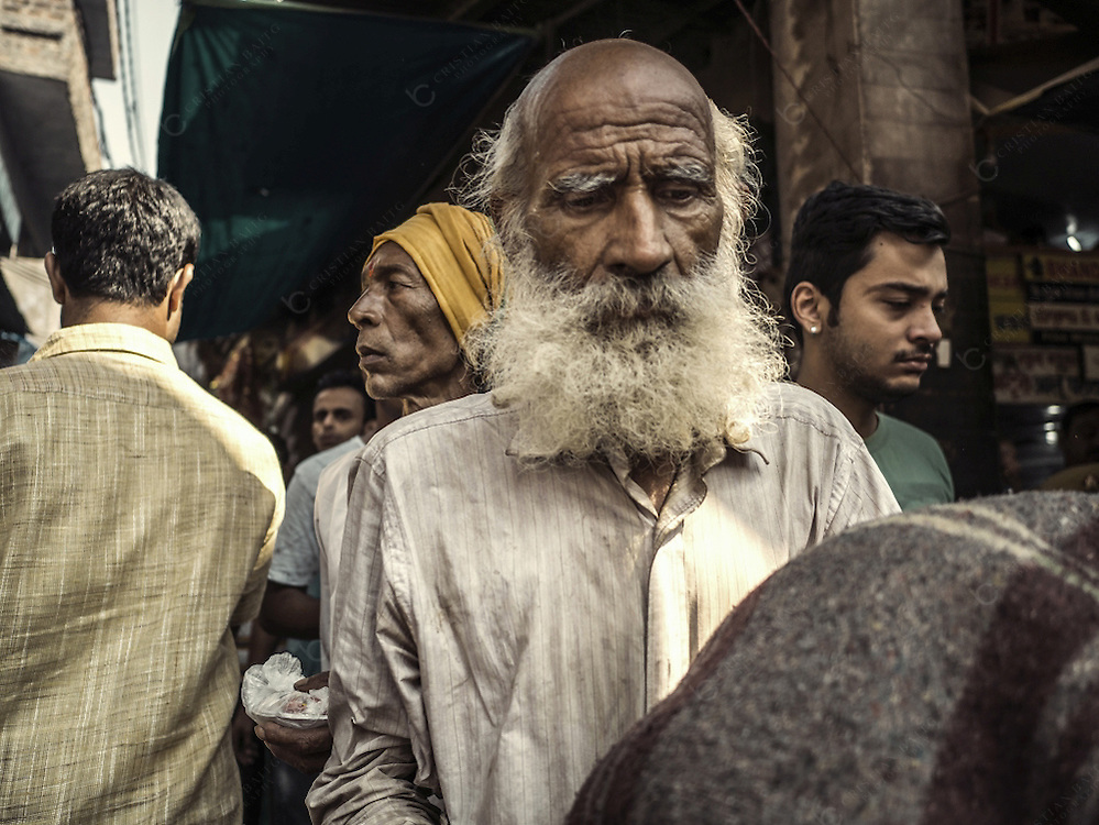 Varanasi, India - October 08, 2015 People in the streets of Varanasi India. This is the holiest city of Hinduism and also one of the oldest inhabited cities in the world with a maze of small alleys and streets along the Ganges river
