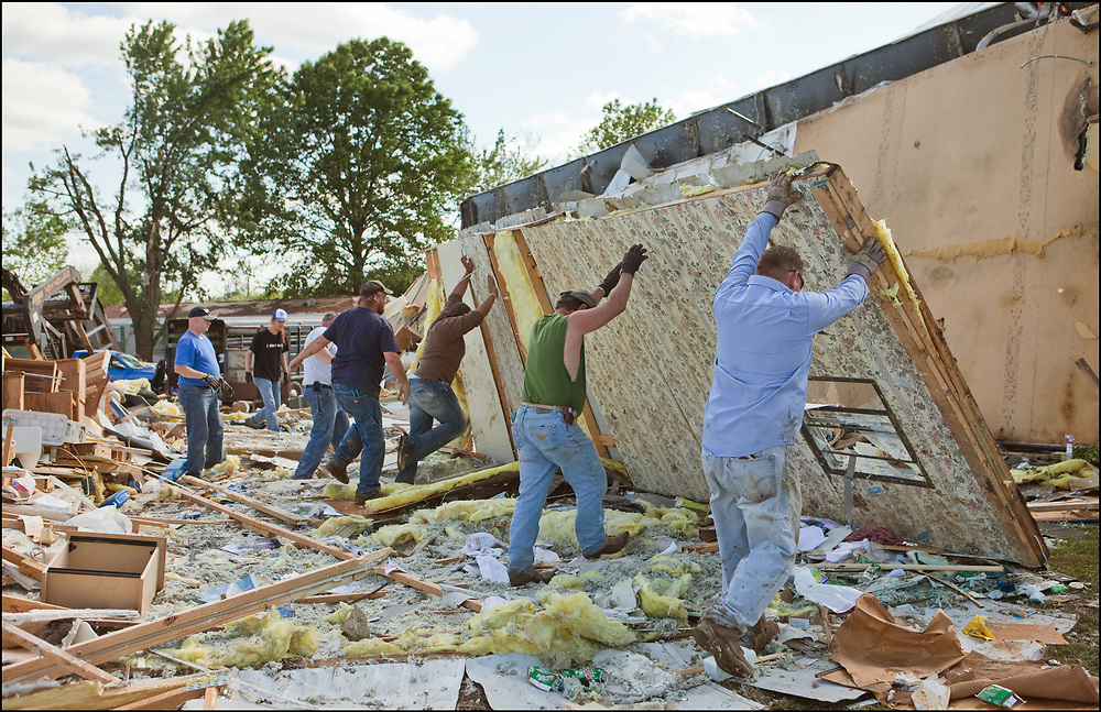 Community members cleaning up the trailer park after an EF-3 tornado went through the town of Sedalia, Missouri.
