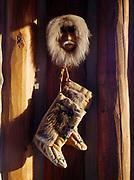Nanamiut Eskimo caribou skin mask from Anaktuvik Pass and Athabascan mukluks on display in an Alaskan log home.