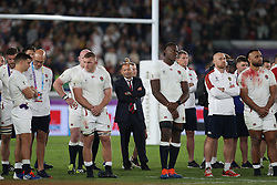 England coach Eddie Jones stands dejected with his players following the 2019 Rugby World Cup final match at Yokohama Stadium.