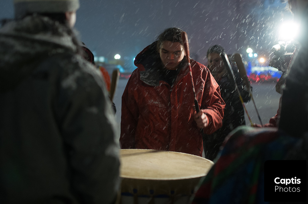 """Drummers play a large drum during a drum circle on Parliament Hill. The drum circle was held to commemorate the second anniversary of the """"Idle No More"""" movement. December 10, 2014. CAPTIS PHOTOS/Brendan Montgomery"""